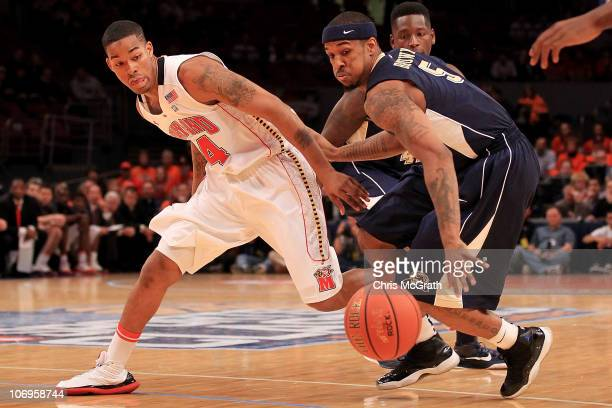 Gilbert Brown of the Pittsburgh Panther contests the ball with Cliff Tucker of the Maryland Terrapins during the 2k Sports Classic at Madison Square...