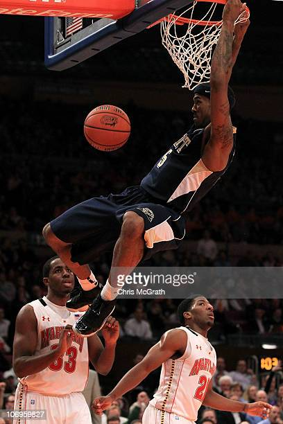 Gilbert Brown of the Pittsburgh Panther dunks against the Maryland Terrapins during the 2k Sports Classic at Madison Square Garden on November 18...