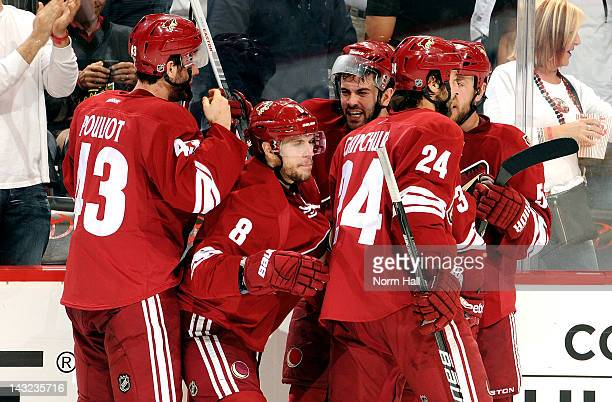 Gilbert Brule and Keith Yandle of the Phoenix Coyotes celebrate with teammates after a goal against the Chicago Blackhawks in Game Five of the...