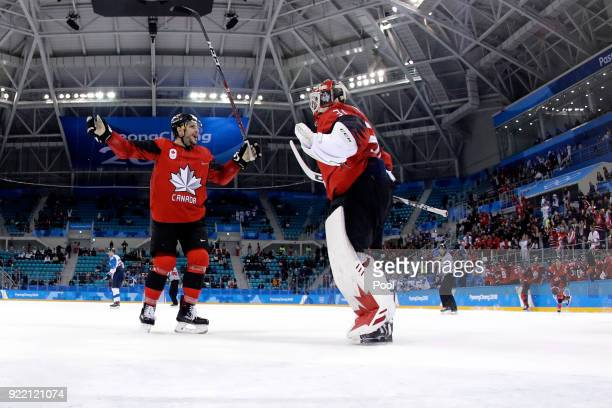 Gilbert Brule and Kevin Poulin of Canada celebrate after defeating Finland 10 during the Men's Playoffs Quarterfinals on day twelve of the...