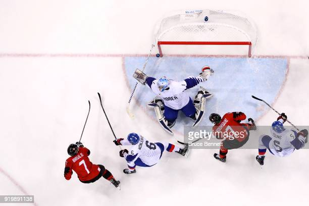 Gilbert Brule of Canada scores a goal against Matt Dalton of Korea in the third period during the Men's Ice Hockey Preliminary Round Group A game on...