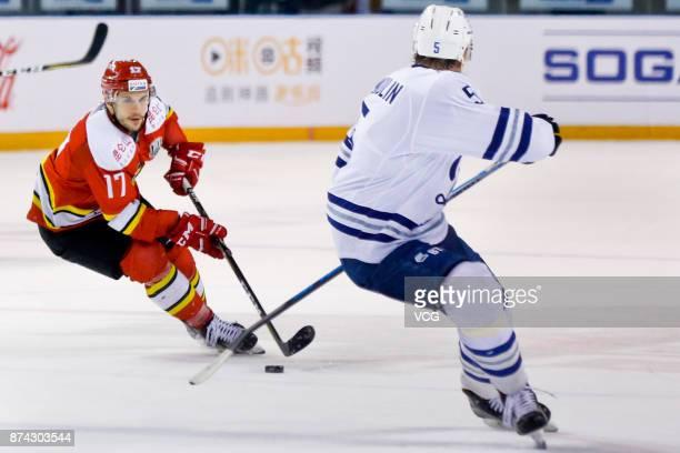 Gilbert Brule of HC Kunlun Red Star vies for the puck during the 2017/18 Kontinental Hockey League Regular Season match between HC Kunlun Red Star...
