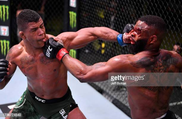 Gilbert Burns of Brazil and Tyron Woodley trade punches in their welterweight fight during the UFC Fight Night event at UFC APEX on May 30 2020 in...
