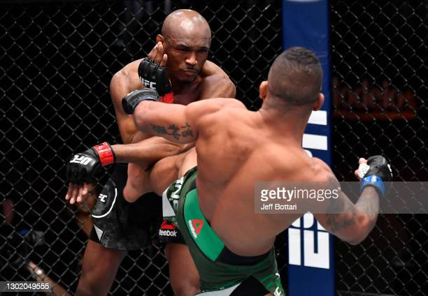 Gilbert Burns of Brazil kicks Kamaru Usman of Nigeria in their UFC welterweight championship fight during the UFC 258 event at UFC APEX on February...
