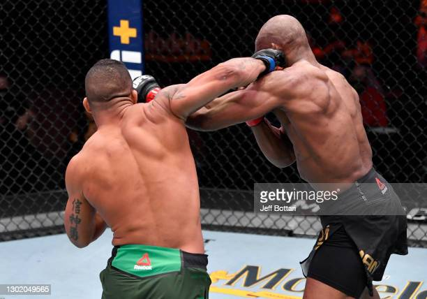 Gilbert Burns of Brazil punches Kamaru Usman of Nigeria in their UFC welterweight championship fight during the UFC 258 event at UFC APEX on February...