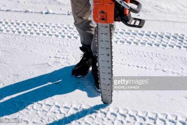 Gilbert Cardin, owner of the ice road connecting the towns of Pointe-Fortune and Saint-Andre-d'Argenteuil, is seen with his notched chainsaw on the...