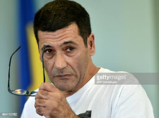 Gilbert Chikli listens to the translator on September 26 2017 in Kiev as part of his trial for tricking dozens of French banks and businesses into...