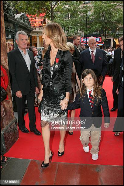 Gilbert Coullier, Celine Dion and son Rene Charles at The Unveiling Of Rene Angelil Wax Statue At Museum Grevin In Paris .