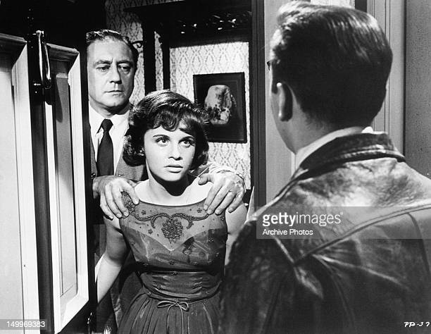 Gilbert Green holding onto daughter Lynn Loring with Bobby Darin at the door in a scene from the film 'Pressure Point' 1962