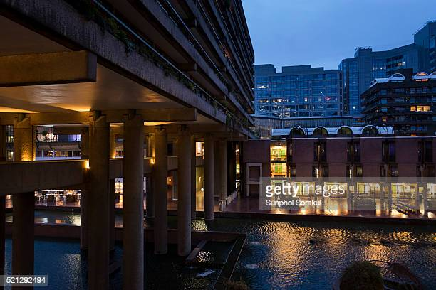 Gilbert house elevated on columns with a pedestrian bridge linking to Guildhall School of Music and Drama