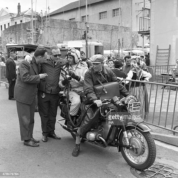 Gilbert Larriaga and reporters' team with motorcycle during the Tour de France 1963