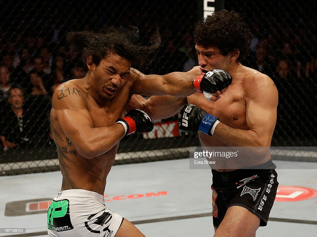 Gilbert Melendez punches Benson Henderson in their lightweight championship bout during the UFC on FOX event at the HP Pavilion on April 20, 2013 in San Jose, California.