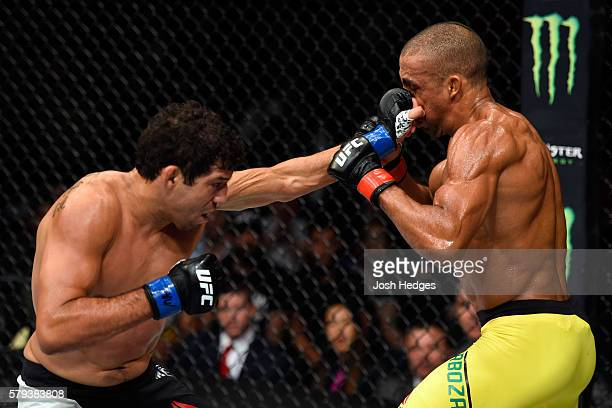 Gilbert Melendez punches Edson Barboza of Brazil in their lightweight bout during the UFC Fight Night event at the United Center on July 23 2016 in...