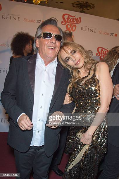 Gilbert Montagne and Jeanne Mas attend the 'Stars 80' Film Premiere at Le Grand Rex on October 19 2012 in Paris France
