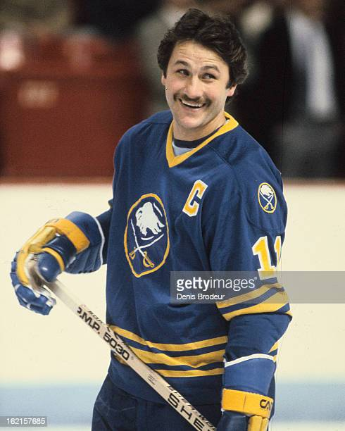Gilbert Perreault of the Buffalo Sabres follows the action during warmups prior to a game against the Montreal Canadiens Circa 1983 at the Montreal...