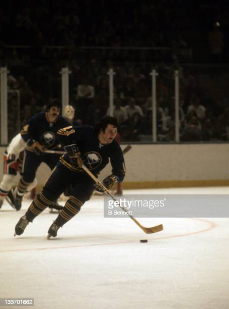 Gilbert Perreault of the Buffalo Sabres skates with the puck during an NHL game against the New York Islanders on December 6 1975 at the Nassau...
