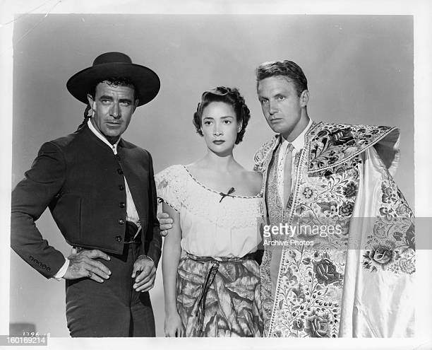 Gilbert Roland Joy Page and Robert Stack in a publicity portrait for the film 'Bullfighter And The Lady' 1951