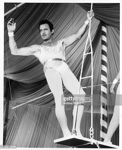 Gilbert Roland prepares to get onto the trapeze in a scene from the film 'The Big Circus' 1959