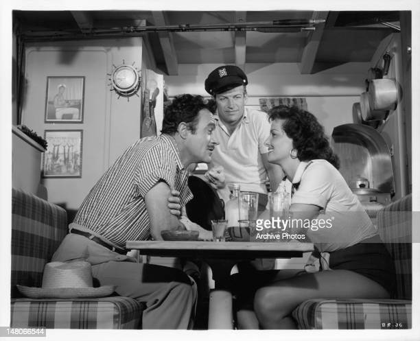 Gilbert Roland Richard Egan and Jane Russell plan their quest for a fabulous sunken treasure in a scene from the film 'Underwater' 1954