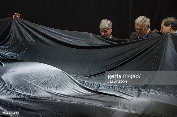 Gilbert Villarreal and Bob Lutz give Michigan Governor Rick Snyder a sneak peak of the VLF Coupe prior to its unveiling at the VLF press conference...