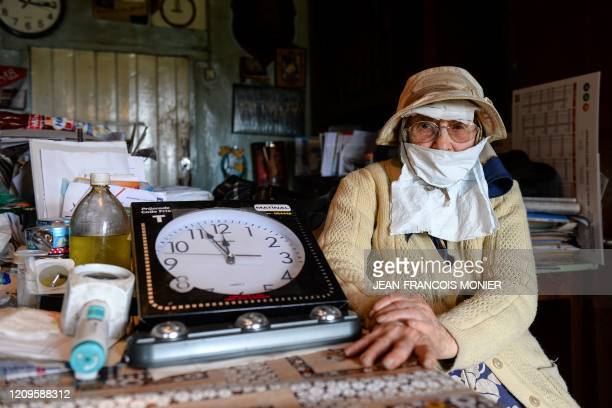 TOPSHOT Gilberte Troquet poses in her house as she wears a makeshift mask in MontignyLeChartif western France on April 8 on the 23rd day of a...
