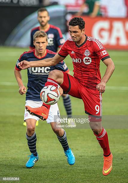Gilberto for TFC control the ball as Scott Caldwell of the Revolution keeps a eye on him during the game between Toronto FC and New England...
