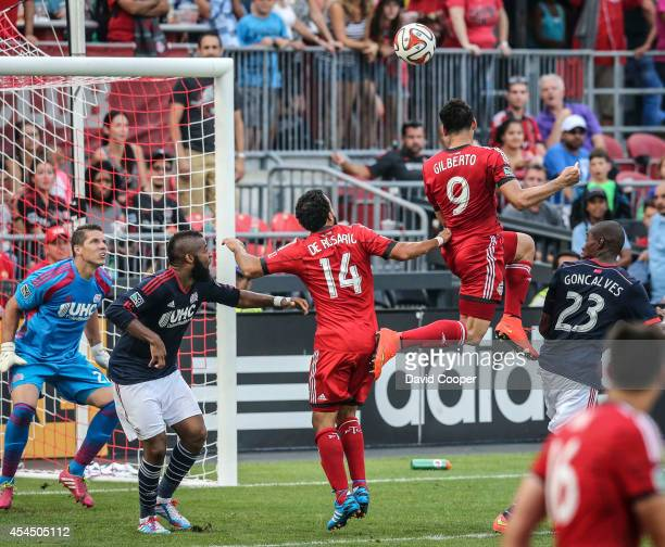 Gilberto for TFC fails to put the ball in the back of the net as he goes up for the header in front of the Revolution Keeper Bobby Shuttleworth late...