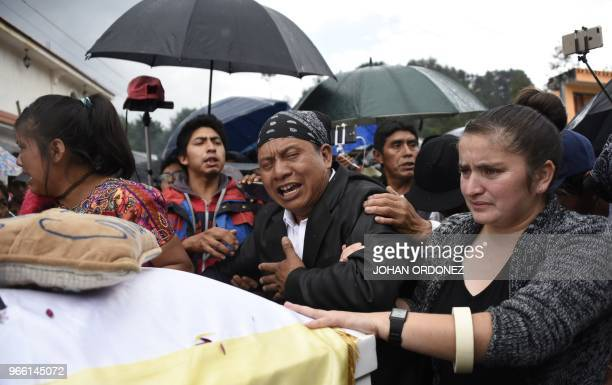 Gilberto Gomez the father Claudia Gomez a 19yearold Guatemalan woman who was allegedly shot and killed by a US border patrol agent mourns over her...