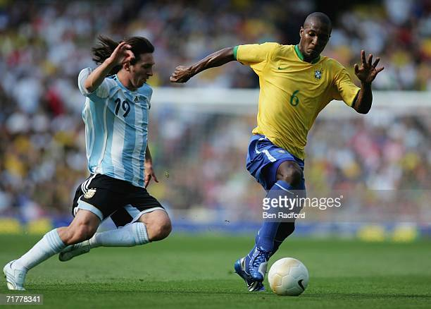 Gilberto Melo of Brazil and Lionel Messi of Argentina compete during the international friendly match between Brazil and Argentina at the Emirates...