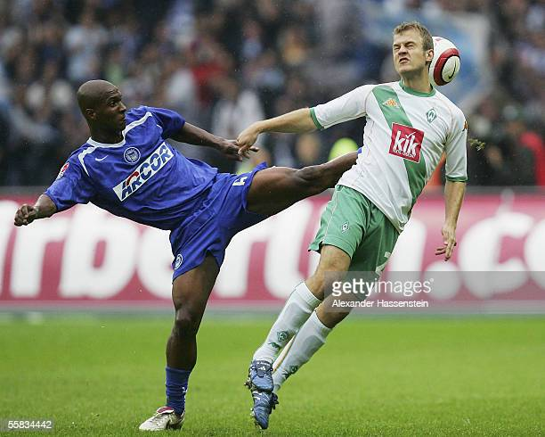Gilberto of Berlin challenges for the ball with Daniel Jensen of Bremen during the Bundesliga match between Hertha BSC Berlin and Werder Bremen at...