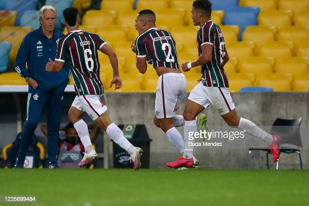 Gilberto of Fluminense celebrates with his teammates Egidio and Evanilson after scoring the first goal of his team during the match between Flamengo...