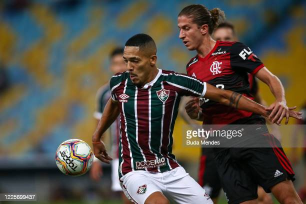 Gilberto of Fluminense fights for the ball against Filipe Luis of Flamengo during the match between Flamengo and Fluminense as part of the Taca Rio...