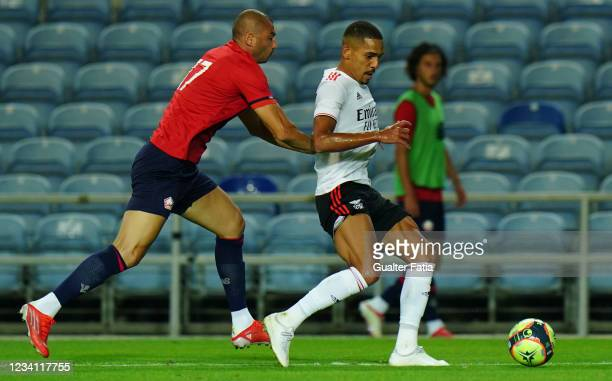 Gilberto of SL Benfica with Burak Yilmaz of LOSC Lille in action during the Pre-Season Friendly match between SL Benfica and Lille at Estadio Algarve...