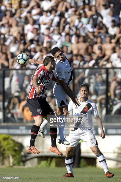 Gilberto of Vasco da Gama struggles for the ball with Lucas Pratto of Sao Paulo during the match between Vasco da Gama and Sao Paulo as part of...