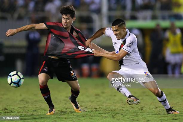 Gilberto of Vasco da Gama struggles for the ball with Matheus Rossetto of Atletico PR during a match between Vasco da Gama and Atletico PR as part of...