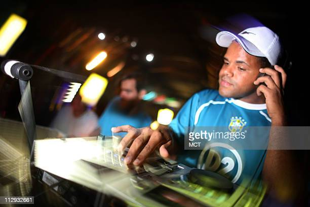 DJ Gilberto plays at a funk dance hall in Rio das Pedras shantytown in Rio de Janeiro Brazil June 9 2006 Like Brazil's trademark genre samba in its...