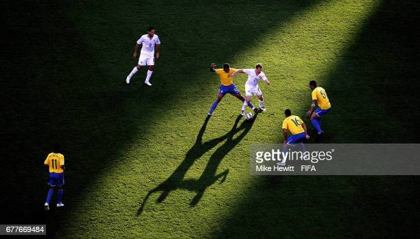 Gilberto Silva of Brazil battles with Jonathan Spector of USA during the FIFA Confederations Cup Group B match between USA and Brazil at the Loftus...
