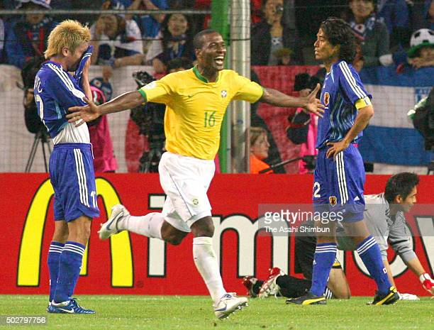 Gilberto Silva of Brazil celebrates scoring his team's third goal during the FIFA World Cup Germany 2006 Group F match between Japan and Brazil at...