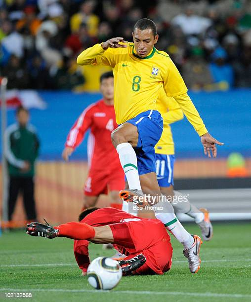 Gilberto Silva of Brazil leaps clear of An Yong Hak of North Korea during the 2010 FIFA World Cup South Africa Group G match between Brazil and North...