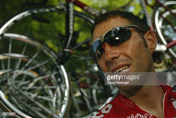 Gilberto Simoni of Italy and riding for Saeco waits in the shade a he prepares for a long and hot stage six of the Tour de France from Nevers to Lyon...