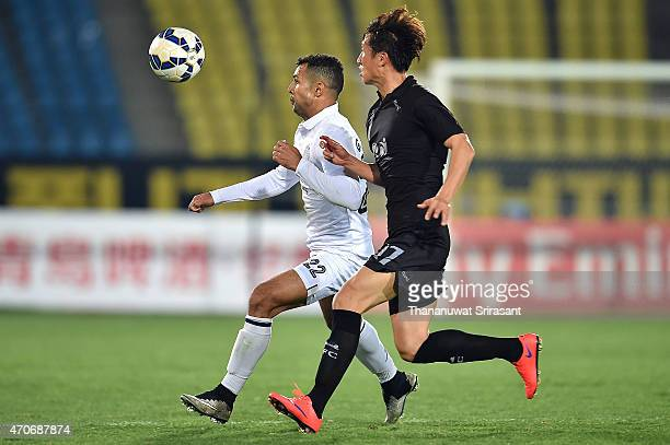 Gilbeto Macena of Buriram United and Park Tae-Min of Seongnam FC look to the ball during the Asian Champions League match between Seongnam FC and...
