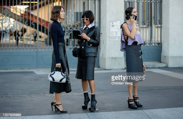 Gilda Amborsio, Giorgia Tordini and Amina Muaddi seen outside Prada during Milan Fashion Week Fall/Winter 2020-2021 on February 20, 2020 in Milan,...