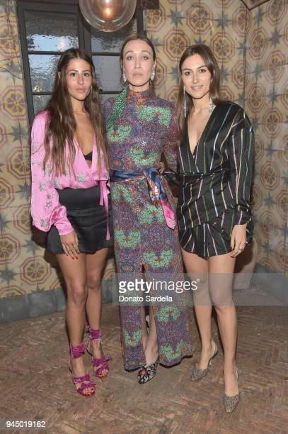 Gilda Ambrosio Alana Hadid and Giorgia Tordini attend Saks Fifth Avenue X Attico Dinner at AOC Wine Bar on April 11 2018 in Los Angeles California