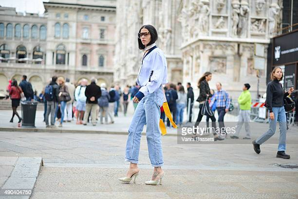 Gilda Ambrosio arrives at the Arthur Arbesser show wearing an Andrea Pompilio shirt and Loewe sunnies during the Milan Fashion Week Spring/Summer 16...