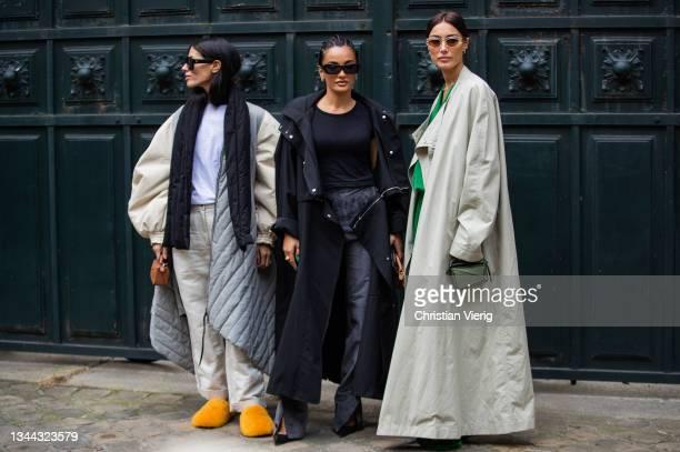 Gilda Ambrosio, Giorgia Tordini and Amina Muaddi seen outside Loewe during Paris Fashion Week - Womenswear Spring Summer 2022 on October 01, 2021 in...