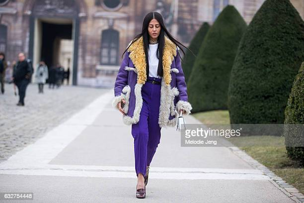 Gilda Ambrosio in a purple Prada coat and purple pants after the Maison Margiela show on January 25 2017 in Paris France