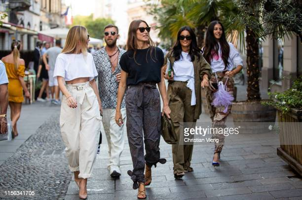 Gilda Ambrosio is seen wearing camouflage pants knotted, blue heels, Amina Muaddi and Georgia Tal outside Palm Angels during the Milan Men's Fashion...