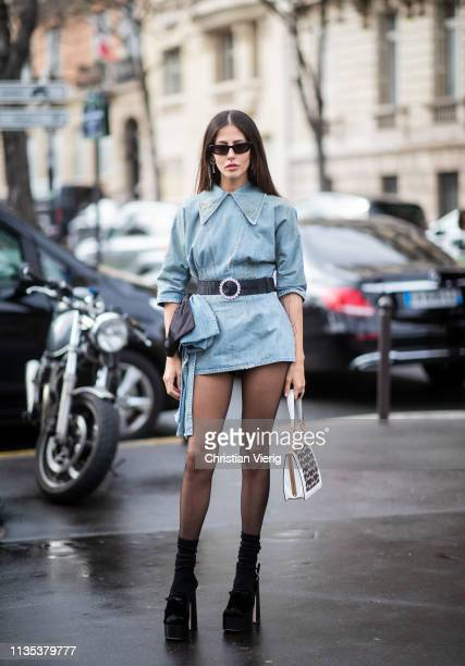 Gilda Ambrosio is seen wearing denim dress sheer tights outside Miu Miu during Paris Fashion Week Womenswear Fall/Winter 2019/2020 on March 05 2019...