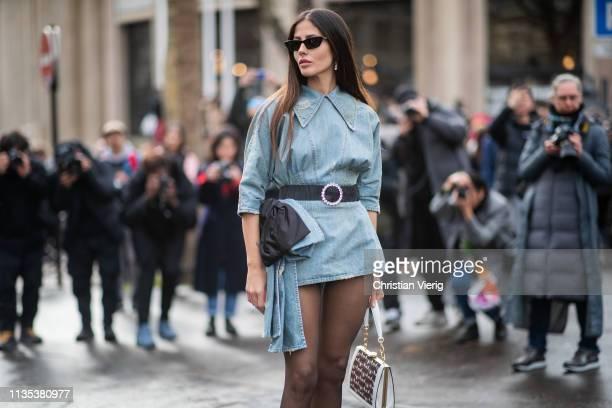 Gilda Ambrosio is seen wearing denim dress sheer tights outside Miu Miu during Paris Fashion Week Womenswear Fall/Winter 2019/2020 on March 05 2019...