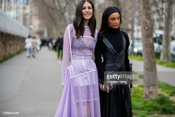 Gilda Ambrosio is seen wearing pink sheer dress and Amina Muaddi wearing black leather dress outside Loewe during Paris Fashion Week Womenswear...